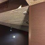 In the hallway, wallpaper peeling, very poor ceiling repair. All for $134. a night!