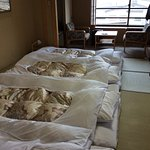 The bedroom in the shibu hotel with a great view of the snow covered mountains
