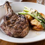O.P rib fillet 450g roast asparagus, smashed potatoes, macadamia nuts