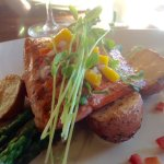 Wild Sockeye Salmon with Mango Salsa, simply grilled on a bed of roasted potatoes and asparagus.