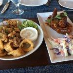 Burger, fish tacos, beer batter fish and chips, fried calamari, ribs, pomegranate blackberry, hi