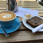 Delicious latte and gluten free banana bread.