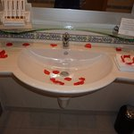 LOVELY RED PETALS DECORATING OUR BATHROOM