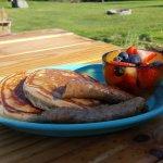 Orange ricotta pancakes and local sausage on the patio!