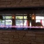 Fireplace built into stone wall in dining room