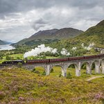 The Jacobite steam train passing over the Glenfinnan Viaduct