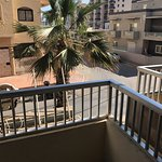 Reception, pool area and view from apartment in the Cardor hotel which is attached.