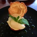 tart apples sliced paper thin in cream with some sort of apple cider mint sauce