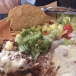 Chille relleno lunch special with a taco. Frijoes smothered with white cheese.