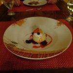 Panna Cotta dessert with fresh fruit at Faisanella Italian Restaurant