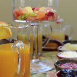 fresh fruits, cooked fruits - rhubarb, apple, prunes as part of continental breakfast.