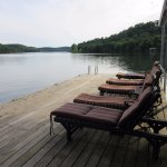 Padded lounge chairs on sunning dock.