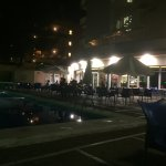 Pool area at night, sit next to it to enjoys drinks at night