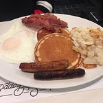 pancakes, eggs, potatoes, sausages, bacon
