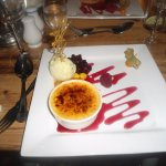 vanilla & pineapple brulee with pistachio ice cream with berries