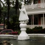 Sto Nino Statue in fountain pool in front to the Shrine