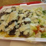 Lamb with rice and salad.