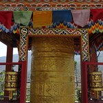 Prayer wheel at the entrance to the resort