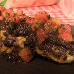 Tortelli ripieni di stracciatella di bufala, olive e pomodoro