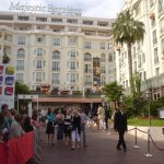 During the Cannes Film Festival, people are waiting to see filmstars coming out of this hotel