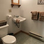 Private bath with full combination tub/shower and local art featured in every room.