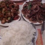 Kung Pao Chicken on the left, and Mongolian beef on the right, with abundant long grain rice.