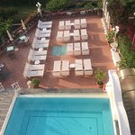view over swimming pool and sun lounges