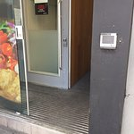 This is the entrance to Wagamama.  Disabled wheelchair users wouldn't be able to enter due to th