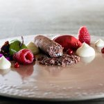 Russian cottage cheese foam with chocolate and raspberry