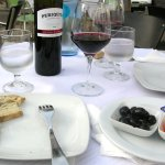 Our aperitif: good red wine, bread and olives