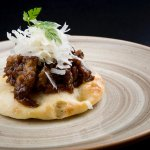 Coca bread withstewed oxtail and parmesan cheese