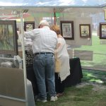 Tourist looking through artists tents