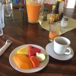 Fruit plate with smoothie and fresh Costa Rican coffee