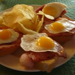 Fried Quail eggs on bacon and bread - this is tapas, superb and free with drinks.