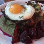 Smoked bone-in pork loin, wild ramp 'romesco', pickled beets, fried egg, grilled walking onions