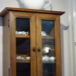 miniature tea sets in display case