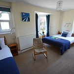 Family room with double and signle bed and a small ensuite shower. Sleeps 3 maximum of 3 people.