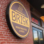 Brick Wood Fired Pizza - sign on front