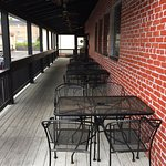 Brick Wood Fired Pizza - outdoor signing tables on deck