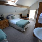 Twin room on top floor with small ensuite shower room.
