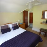 Room 7: compact double ensuite on the top floor. Small ensuite shower room.