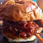 Dr. Pepper BBQ Pulled Pork on a toasted Milwaukee Pretzel bun!