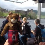 Taking a fun photo of my mascot on our boat tour of Loch Ness.