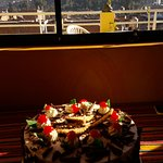 Surprise birthday cake from the owner and great view behind