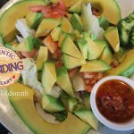 An Off-the Menu Order: Extra Avocado & Tomato - dipped into Slightly Spicy Vinaigrette.