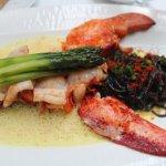 Lobter w/cuttlefish ink pasta & lobster roe in saffron cream sauce w/asparagus & Jerusalem artic