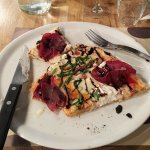 Pizza with basil, thyme, balsamic vinegar, aged ham and fig