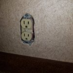 No plate cover on electrical outlet