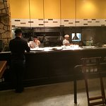 Open kitchen at Romano's Macaroni Grill that's located in a corner