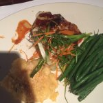 Crab crusted cod with crab fried rice and pan Asian glazed Chilean sea bass with au gratin potat